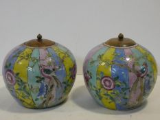 A pair of 20th century Chinese wooden lidded colourful glaze jars with flowers, birds and insects.