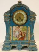 A 19th century ceramic cased mantel clock in pale blue glaze and gilt highlights, enamel and gilt