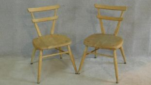 A pair of vintage Ercol child's chairs in blonde beech and elm on turned stretchered supports. H.