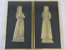 A pair of gilt framed and glazed brass rubbing panels, medieval figures. H.65xW.34cm