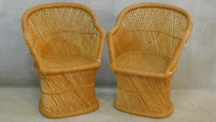 A pair of vintage woven rattan tub form conservatory chairs. H.85cm