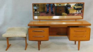 A mid century vintage teak G-Plan dressing table with its matching stool with faux lambswool seat.