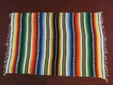 A flatweave Central American kelim in multicoloured bands. H.210xW.148cm