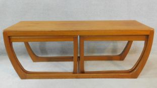 A 1970's vintage teak nest of three coffee tables. H.45 W.122 D.46cm (largest)