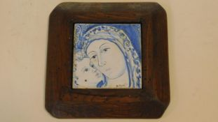 A framed painted ceramic tile, head study of the Madonna and child, signed B, Morrell. 19x19cm