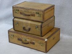 A pair of vintage leather Hartmann Skymate suitcases together with a similar Mendel Cincinnati