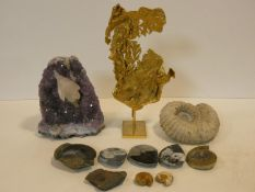 A gilt metal model of a nugget of gold on a stand, an amethyst rock sample and a miscellaneous