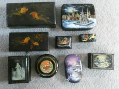 A collection of nine black lacquered trinket and pill boxes, Russian, Japanese and Indian each