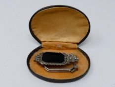 A cased Art Deco German marcasite and onyx metamorphic lorgnette/brooch with geometric design,