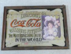 A framed vintage Coca Cola advertising mirror. 99x68cm