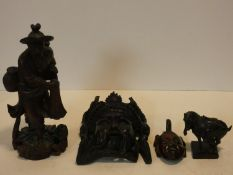 A collection of Chinese figures and masks. Including a resin wood effect mask, a carved wooden