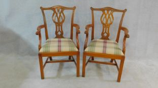A pair of Chippendale style mahogany open armchairs with carved back splats and drop in seats on