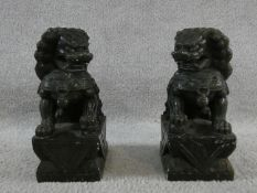 A pair of Chinese carved greenstone seated Dogs of Fo figures. H.23cm
