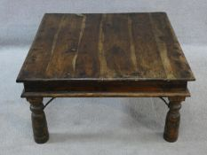 An Indian iron bound hardwood low table on circular section supports. H.42xW.80xL.80cm