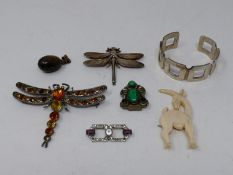 A collection of vintage jewellery. Including two dragonfly brooches, an antique ivory gazelle