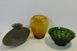 Art glass: A bulbous vase, an amber baluster shaped vase and a ribbed green glass bowl. H.29cm