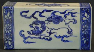A Chinese ceramic flower brick with pierced top and blue and white dragon decoration in floral
