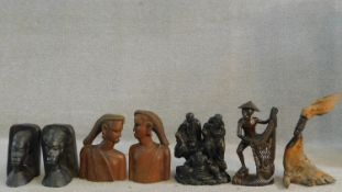 A collection of African hard wood carvings to include two pairs of head and shoulder studies, a
