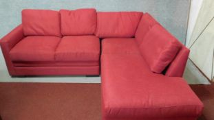 A contemporary L-shaped sofa in rose upholstery. H.71 W.190 (long end) W.134 (short end) D.80cm