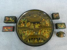 A collection of hand painted Persian/Indian gilded lacquer boxes and a similar circular tray.