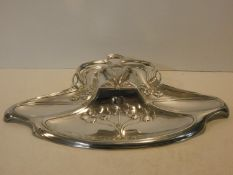 A late 19th century silver plated desk stand with all over flowing foliate Art Nouveau motifs fitted