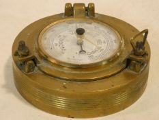 A small Italian ship's barometer in brass case. 11x11cm