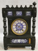 A late 19th century ebonised Gothic style bracket clock with blue and white ceramic dial and