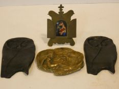 A 19th century brass framed oil on ceramic panel of the Madonna and Child and two bronze stylised