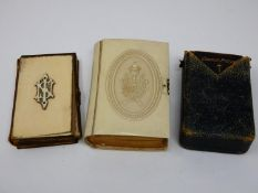 A 19th century leather bound bible with ivory cover and monogram, a similar in a faux ivory cover