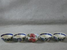 A set of five Spanish ceramic bowls with hand painted floral design. Makers stamp to the base.