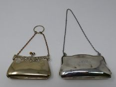 A silver and silver plated finger held ladies coin purse. The silver plated purse has a repousse