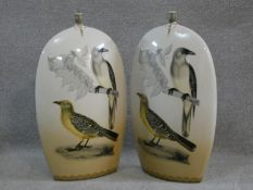 A pair of large contemporary transfer design ceramic vases with oriole birds, one perched on a