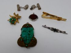 A collection of jewellery. Including an Art Deco jade glass and brass fruit design pendant, a pair
