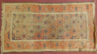A Shirvan rug with all over repeating lozenge decoration within stylised terracotta border. 98x180cm