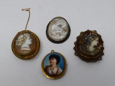 A collection of antique brooches and pendants. Including two craved shell cameos with classical