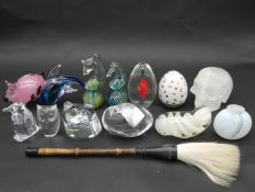 A collection of paperweights and Art Glass, crystal skull, hand painted porcelain egg paperweight
