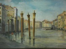 A large gilt framed and glazed watercolour, Venetian canal scene with figure seated on a quay,