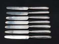 A set of seven antique silver fruit knives, handles and blades hallmarked, four marked Samuel Hennel
