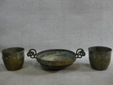 A pair of brass jardinieres with Adam style husk and ribbon decoration and a brass twin handled