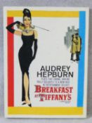 A vintage style advertising print on canvas, Breakfast at Tiffany's starring Audrey Hepburn. 79x60cm