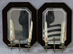 A pair of Victorian girandoles in deep burgundy velvet frames inset with beaded glass mirrors each