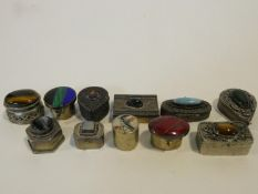 A miscellaneous collection of eleven miniature lidded cases and pill boxes to include, white metal