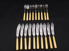 A set of ten 19th century silver plated fish knives and forks with pierced and engraved design and