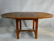 A contemporary teak slatted top garden table with extension leaf. H.77 W.190 D.120cm