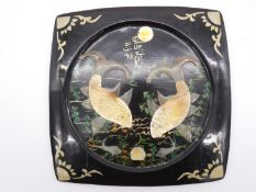 A Japanese lacquered wall hanging platter with painted and applied horn decoration depicting carp