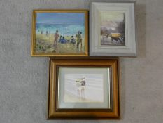 A framed and glazed watercolour, children on a beach, signed and two framed oils on canvas, a