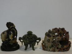A Chinese carved soapstone lidded censer, a soapstone Dog of Fo on carved wooden base and a