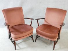 A pair of mid century vintage Ercol beech framed salon chairs in dusty pink velour upholstery. H.82c