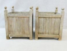 A pair of weathered teak garden planters. H.56 W.45 D.45cm