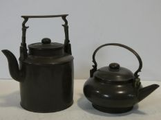 Two Chinese Yixing Pottery teapots with cast brass handles and finials and banding around the edges,